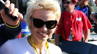 Pamela Anderson walks on the grid before the