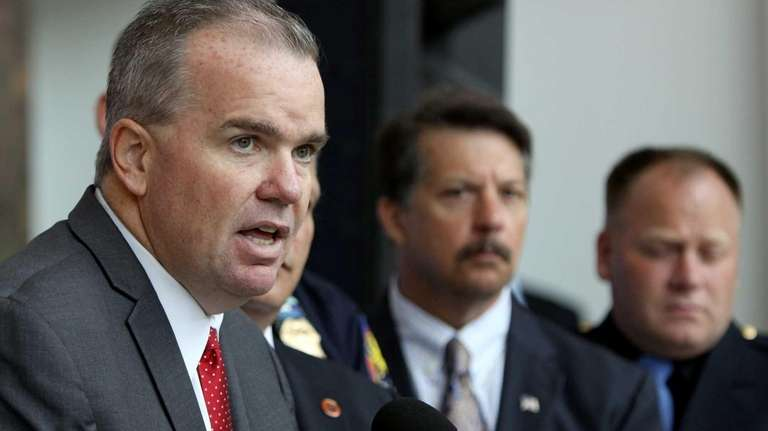 Acting Police Commissioner Thomas Krumpter speaks at the