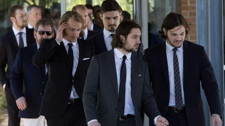 Rangers players leave the funeral home following services