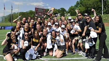 Adelphi poses for a photo following their victory