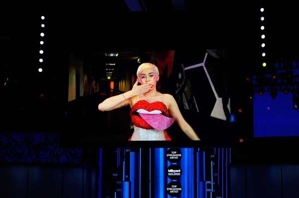 Miley Cyrus speaks via satellite during the 2014