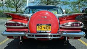 This is a 1959 Chevrolet Impala being shown