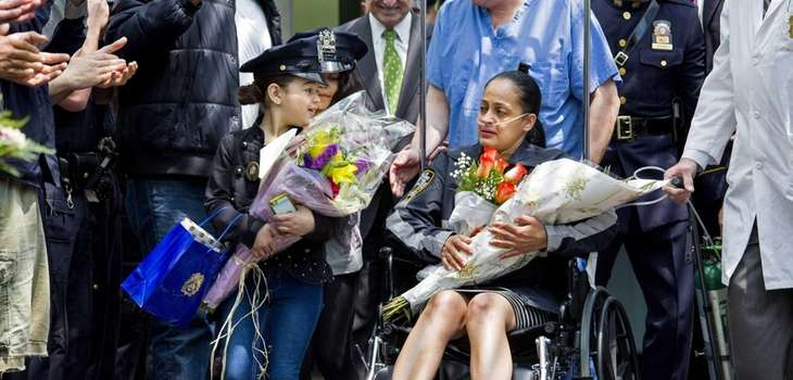 Police Officer Rosa Rodriguez is wheeled from Weill
