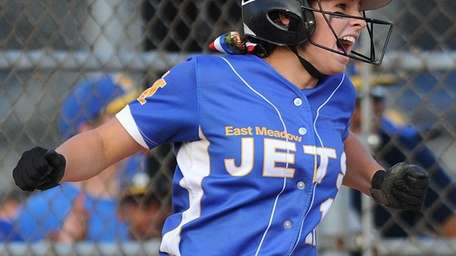 East Meadow shortstop No. 18 Claire Travis reacts