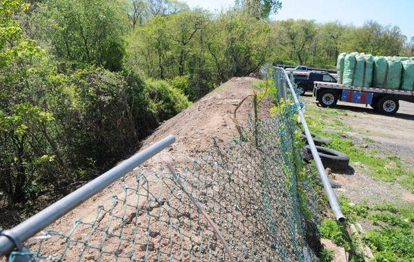 A 300-foot berm of debris on the eastern
