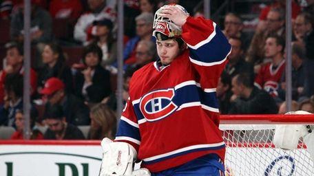 Dustin Tokarski #35 of the Montreal Canadiens reacts