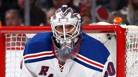 Henrik Lundqvist reacts after a play against the