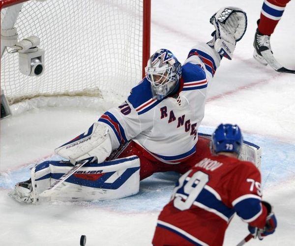 Rangers goalie Henrik Lundqvist stops Montreal Canadiens defenseman