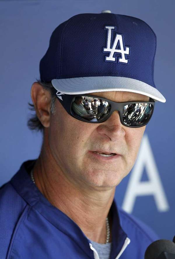 Los Angeles Dodgers manager Don Mattingly talks with