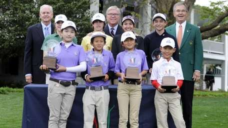 Lucy Li, front left, poses with winners of