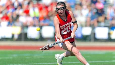 Sacred Heart attacker Kathleen Berkery scoops up a