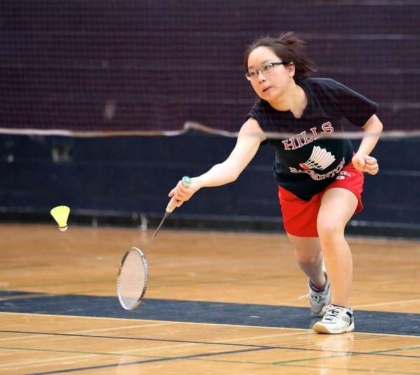 Half Hollow Hills' Monica Chen returns the volley