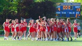 Sacred Heart celebrates at midfield after defeating Kellenberg