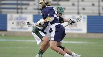 Bethpage midfielder Michael Sforza wins the face-off against