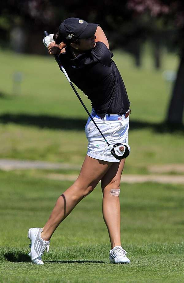 Garden City's Sam Sessa tees off on the