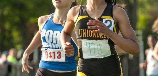 Uniondale's Kristina Cherrington, right, beats Port Washington's Joelle