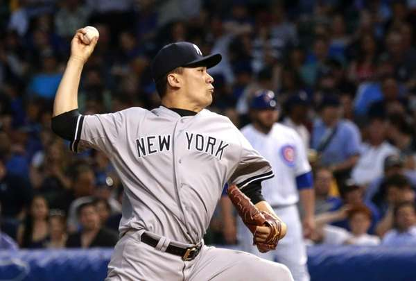 Yankees starting pitcher Masahiro Tanaka delivers during the