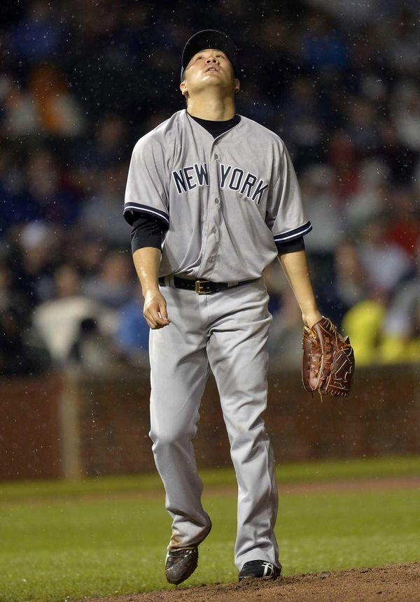 Starting pitcher Masahiro Tanaka of the Yankees stands