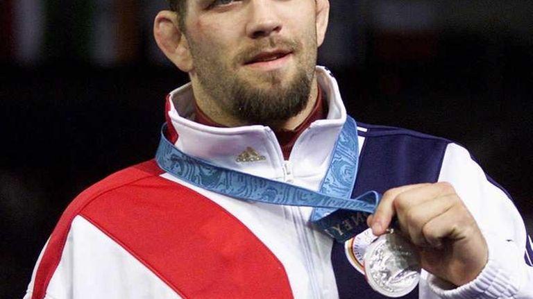 Matt Lindland of the United States shows off