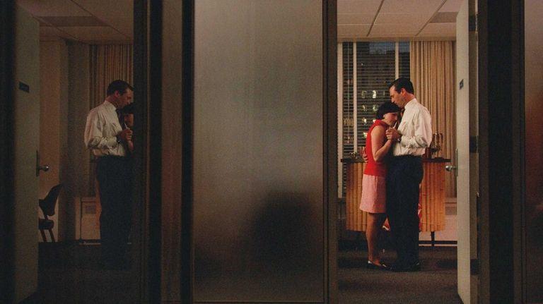 Elisabeth Moss as Peggy Olson and Jon Hamm