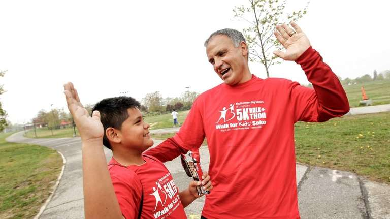 Juan Carlos, 11, gives a high five to