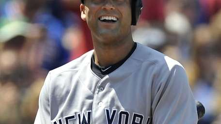 The Yankees' Derek Jeter reacts to striking out