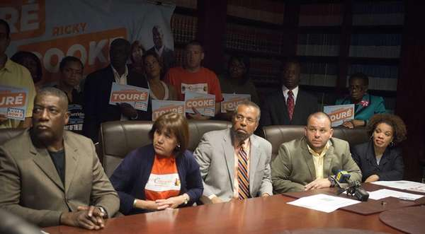 Maribel Touré, attorney Fred Brewington and Ricky Cooke