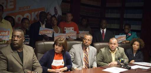 Maribel Toure, attorney Fred Brewington and Ricky Cooke