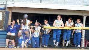 Kellenberg's Krista King is congratulated by teammates in