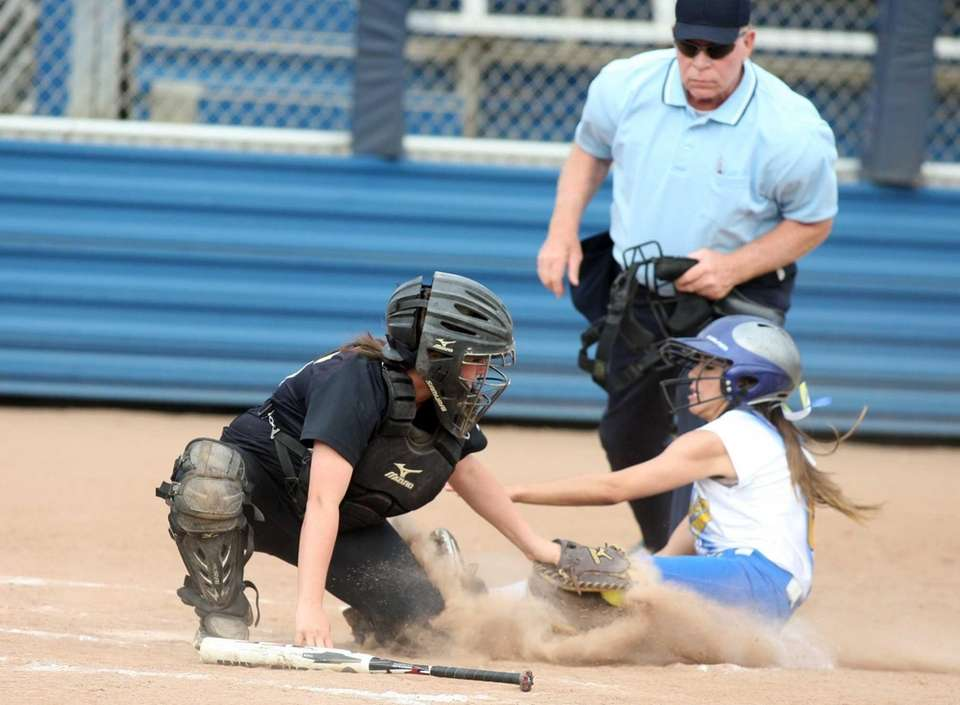 Kellenberg's Brittany LoGrande is tagged out on a