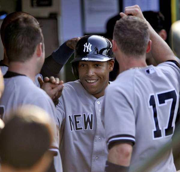The Yankees' Yangervis Solarte celebrates with teammates after
