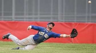 West Islip's Sam Ilario (11) dives for a