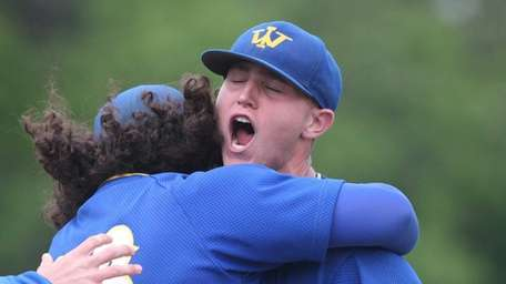 West Islip's James Kory (26) is congratulated by