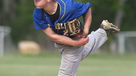 West Islip's James Kory delivers a pitch in