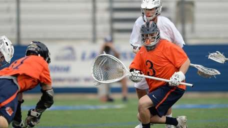 Manhasset goalie John Young reacts to the ball