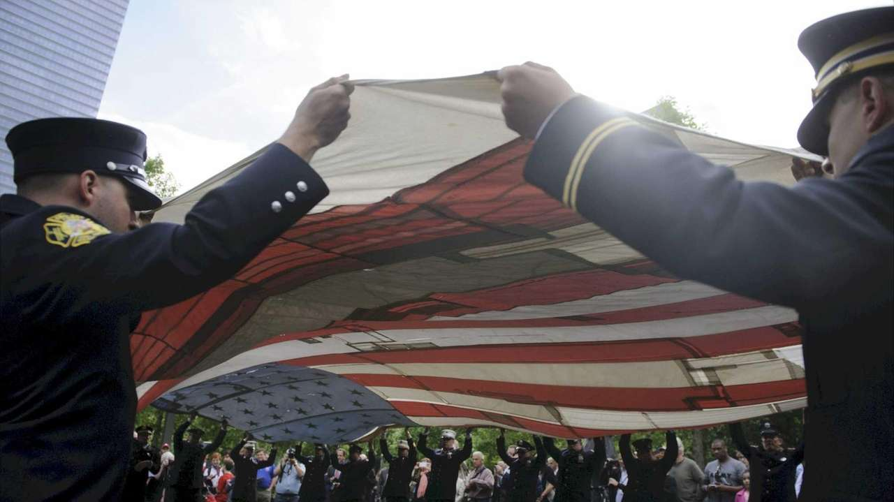 The National 9/11 Flag is unfurled during a