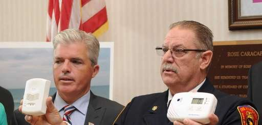 Suffolk County Chief Fire Marshal Ed Springer holds