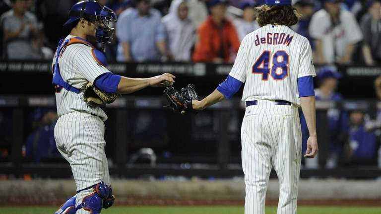 Mets' starting pitcher Jacob DeGrom watches Los Angeles'
