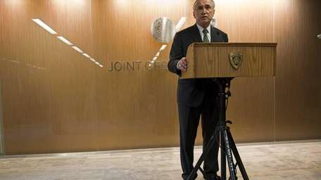 NYPD Commissioner William Bratton addresses the media after