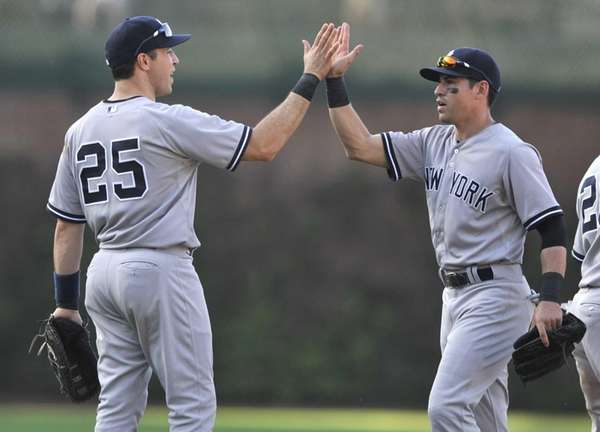 Yankees' Mark Teixeira celebrates with Jacoby Ellsbury after
