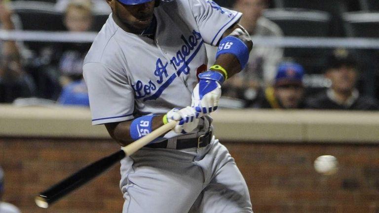 Los Angeles Dodgers' Yasiel Puig homers against the