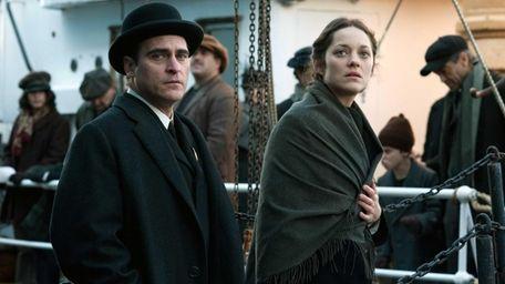 Joaquin Phoenix, left, and Marion Cotillard in a