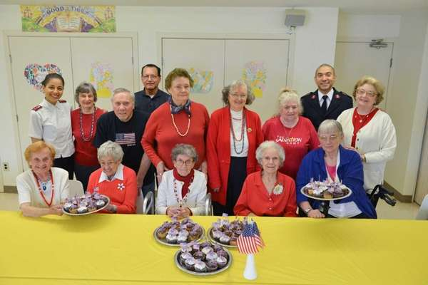 Salvation Army volunteer Judy Lewis, standing second from