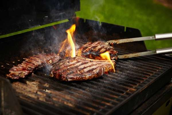 Butcher Lou Kreitzman grills hanger, rib-eye and porterhouse