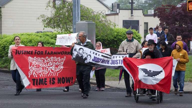 Worker and immigrant-rights activists rally to call to