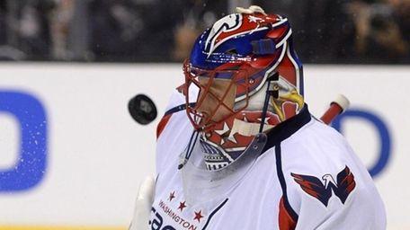 Washington Capitals goalie Jaroslav Halak deflects a shot