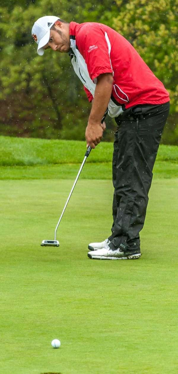 Middle Country's Michael Miranda putts during the Suffolk