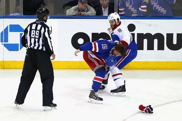 Derek Dorsett of the Rangers fights with Brandon