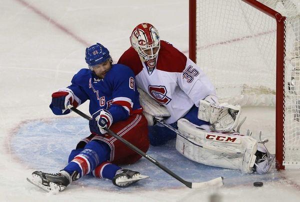 Dustin Tokarski #35 of the Montreal Canadiens denies