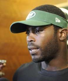 Jets quarterback Michael Vick speaks to the media